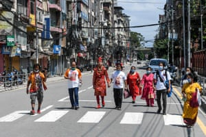 A devotee dressed as Hindu deity Ganesh walks with a few other devotees on an empty street in Kathmandu, Nepal, as large gatherings are restricted due to coronavirus measures, for the annual Indra Jatra festival, on 30 August, 2020. The eight-day long festival 'Indra Jatra' celebrates the Hindu king of gods and god of rains Indra and is also usually marked by the Kumari Jatra, the religious procession of the living goddess Kumari.