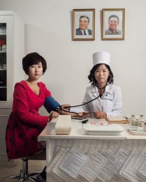 Doctor Ri Su Rim examines Miss Yu Hyang Suk at the Zhenghsu Pyongyang textile factory (October 2017)