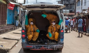 In October 2014, volunteers arrive in Freetown, Sierra Leone, to help with efforts to fight Ebola