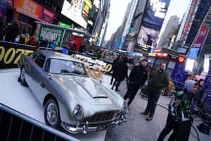 An Aston Martin DB5 is displayed in Times Square, New York, during a promotional tour for No Time to Die.
