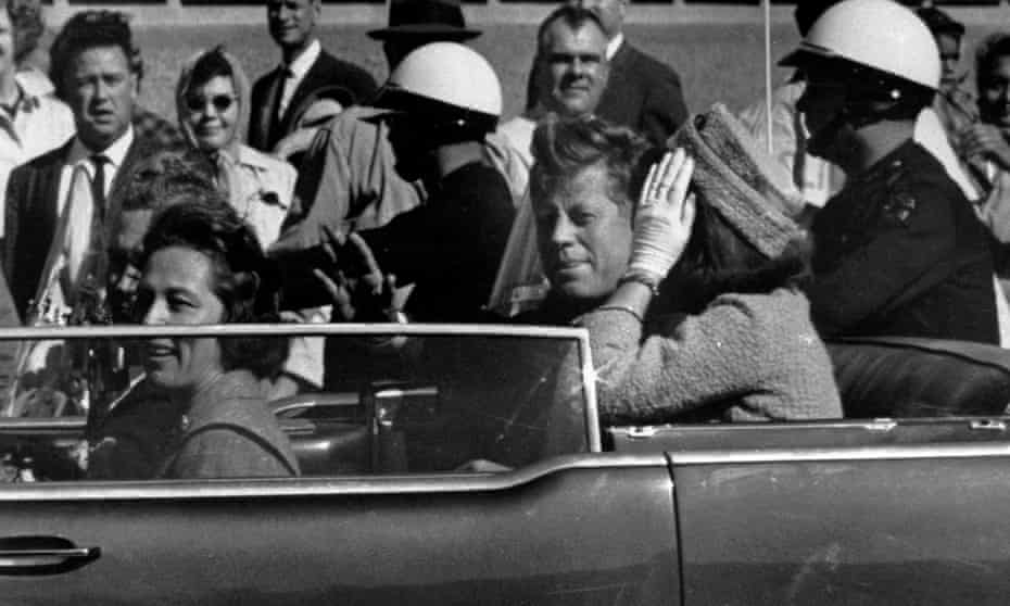 President John F Kennedy is seen riding in motorcade approximately one minute before he was shot in Dallas on 22 November 1963.