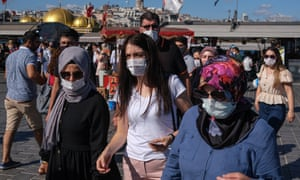 People wearing face masks as they shop at the Eminonu local bazaar in Istanbul, Turkey.