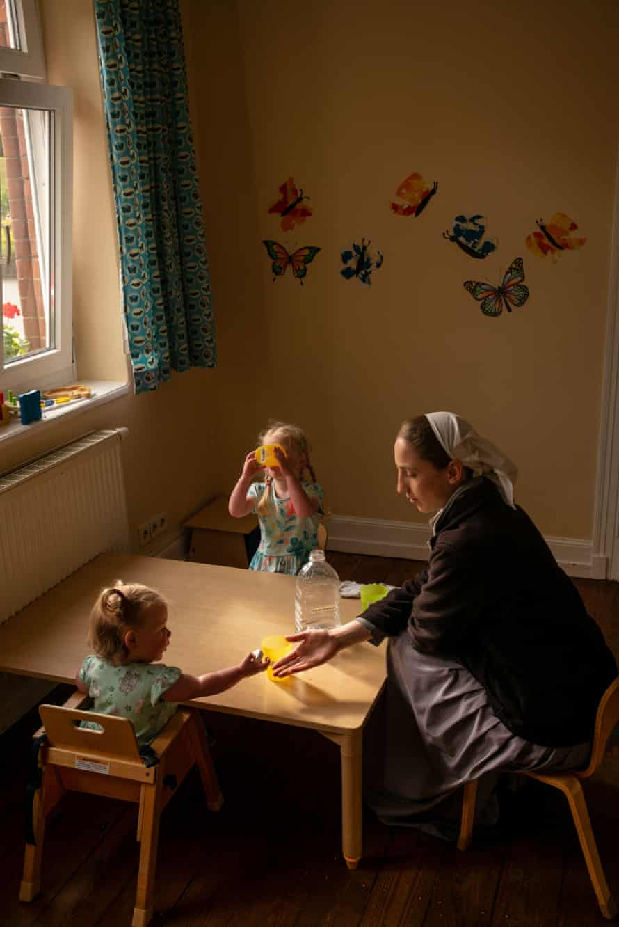 Children being looked after by a nanny, Sannerz, Germany