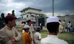 Pakistani seminary students gather outside Bin Laden's final hiding place in Abbottabad, 2011.