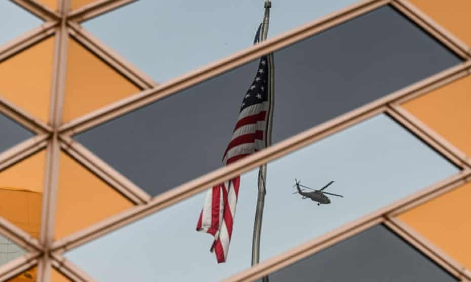 The Stars and Stripes is reflected on the windows of the US embassy building in Kabul.