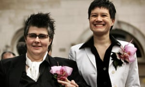 Grainne Close (left) and Shannon Sickles pose for photographers after becoming the first gay couple to enter a civil partnership in the UK in 2005.