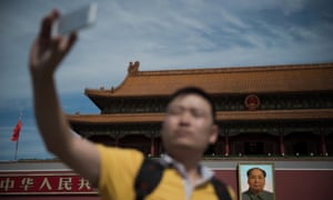 A man takes a selfie with his smartphone in front of a giant portrait of Mao Zedong at the gate of the Forbidden City in Beijing on 9 September 2016, the 40th anniversary of the death of Communist China's founding father.