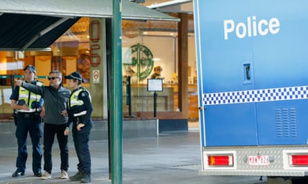 Police speak with the public in Melbourne on Saturday, a day after a man went on a stabbing frenzy on Bourke Street. Police declared the event a terrorist attack.