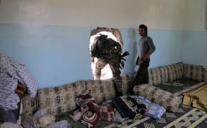 A member of the Syrian Democratic Forces moves from house to house in Raqqa to hide from Islamic State's sniper