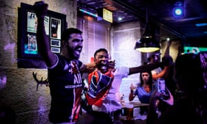 PSG supporters celebrate at a bar in Lisbon
