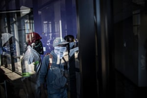 Masked students enter a building of the prestigious Witwatersrand University in Johannesburg to disrupt classes in a bid to shut down the campus