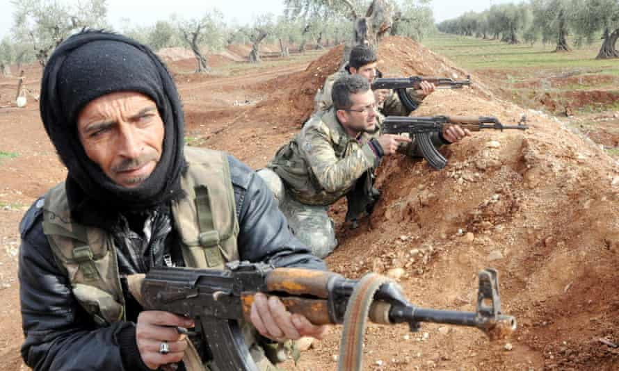 Turkish-backed Free Syrian Army fighters in the Syrian town of Azez near the border with Turkey.
