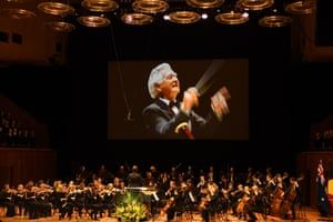 An image of Bob Hawke is projected on to the big screen at the memorial for the former Labor prime minister in the Sydney Opera House concert hall.