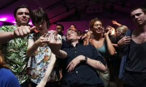 """Attendees celebrate during the """"00:01"""" event organised by Egyptian Elbows at Oval Space nightclub."""