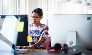 Businesswoman working at workstation in modern high-tech office