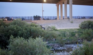 Ledy Perez and her son Anthony cross the Rio Bravo river to enter the US after escaping from members of the Mexican National Guard, as seen from Mexico. They were taken into US border patrol custody