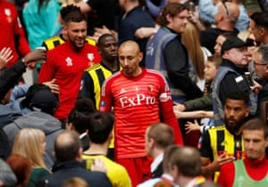 Watford's Heurelho Gomes, Abdoulaye Doucoure and team mates walk down the steps after receiving their losers' medals.