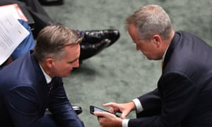 Chris Bowen and Bill Shorten during Question Time. Labor initially said it would implement all the royal commission recommendations.