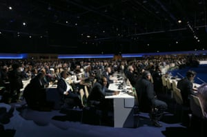Delegates listen to a speech during the opening session of COP21 in Paris