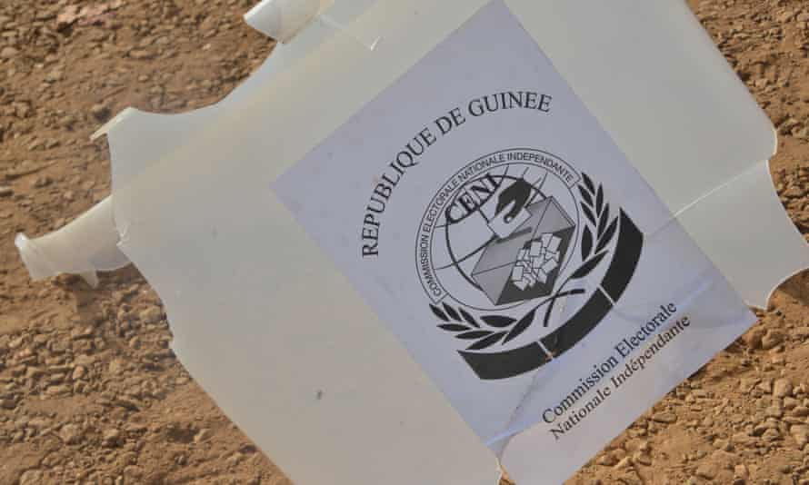 A broken ballot box on the ground outside a polling station in Conakry on the day of Guinea's constitutional referendum