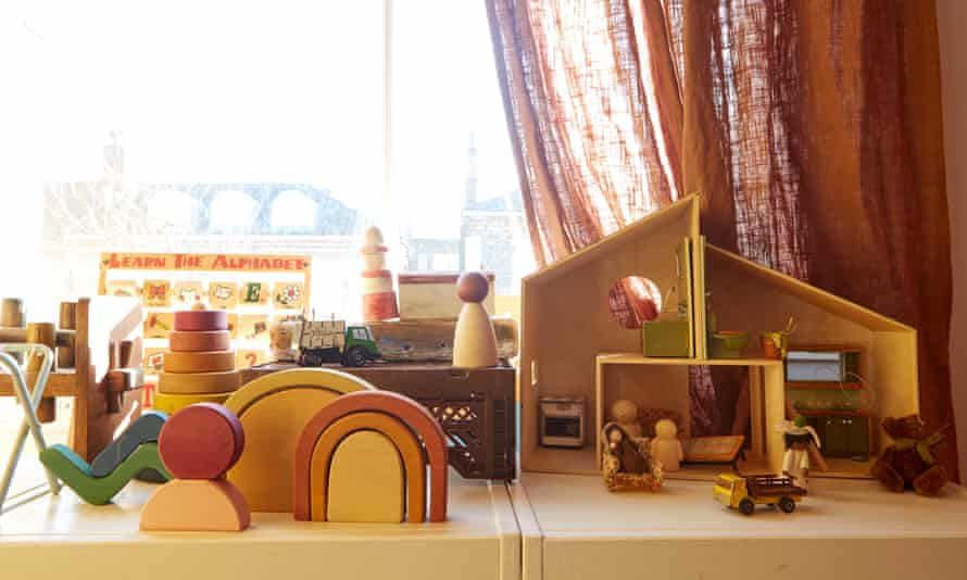 Building a home: wooden toys in the girls' bedroom.