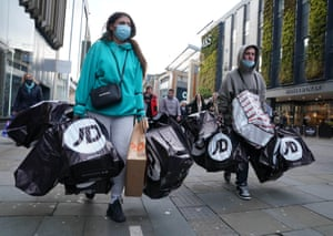Newcastle, England. Shoppers laden with bags as non-essential shops open their doors to customers for the first time in a month
