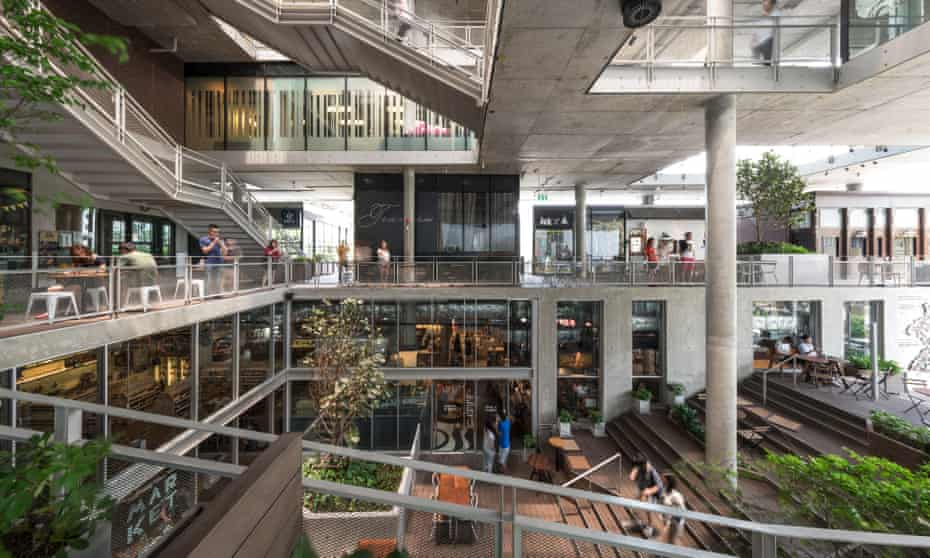 The Commons shopping mall features a market style eatery at ground level and a grassy roof area for children on the fourth floor.