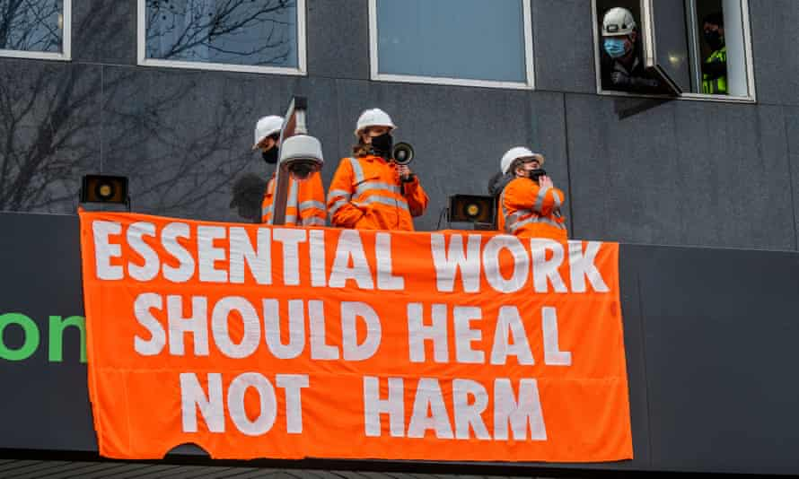 Protesters climbed on to a canopy roof at HS2's headquarters in London on Tuesday
