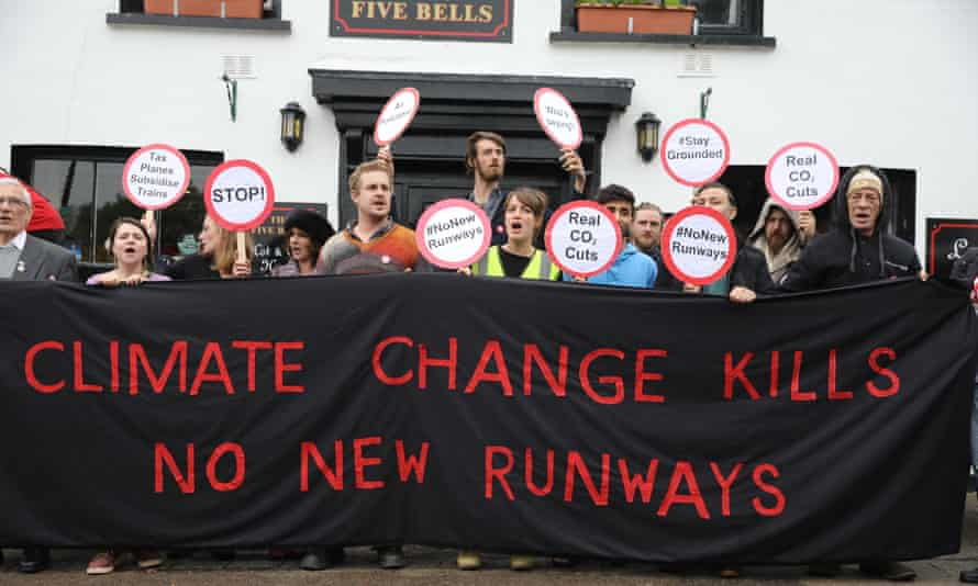 Residents of Harmondsworth protest outside the Five Bells pub