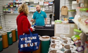 Tim Steele serves a customer at his Weigh and Save market stall in Barnsley.
