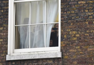 Downing Street employees pull back the curtains