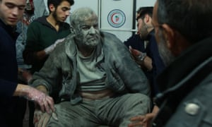 A wounded Syrian man saved from the rubble arrives at a makeshift hospital in eastern Ghouta.