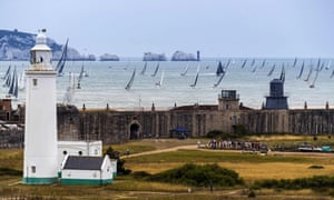 The fleet of the 2019 Rolex Fastnet race passes off the south coast of England.