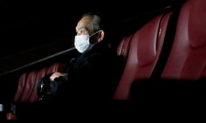 A man wears a protective mask as he watches a movie in Hong Kong on 10 February.