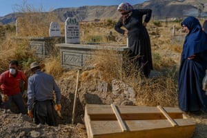 Women gather in the cemetery to point out their graves, which are to be removed from the old cemetery to the new Hasankeyf cemetery