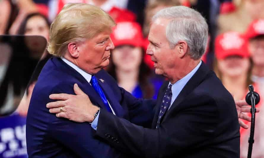 Donald Trump embraces Wisconsin senator Ron Johnson at a rally in January last year.