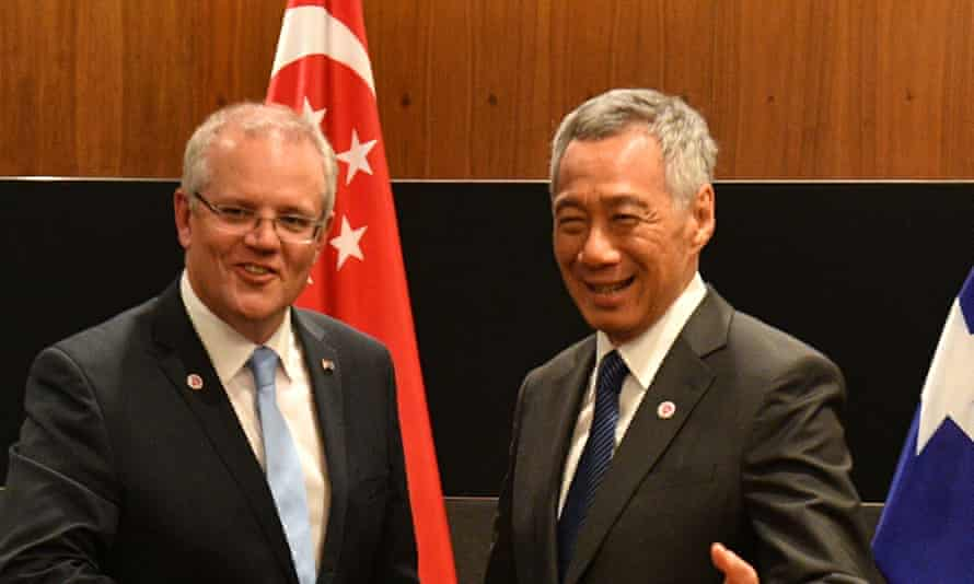 Australia's prime minister Scott Morrison (left) and Singapore's PM Lee Hsien Loong, pictured here in 2018. The pair are due to meet and commit to the idea of a travel bubble between their two countries.