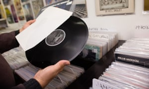 A man browses records for sale in Bristol. Supermarkets such as Sainsbury's and Tesco now also stock records.