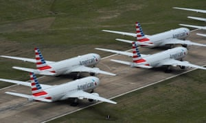 American Airlines passenger planes parked on a runway.