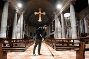 The last of the water is mopped away inside a church
