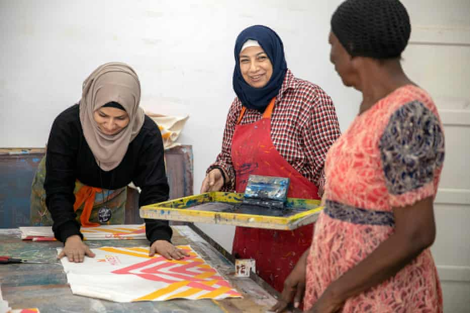 Workers producing screen printed bags in their Cairo workshop, Egypt
