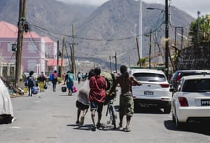 People carrying looted goods in Roseau
