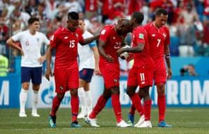 Baloy celebrates with team mates after scoring.