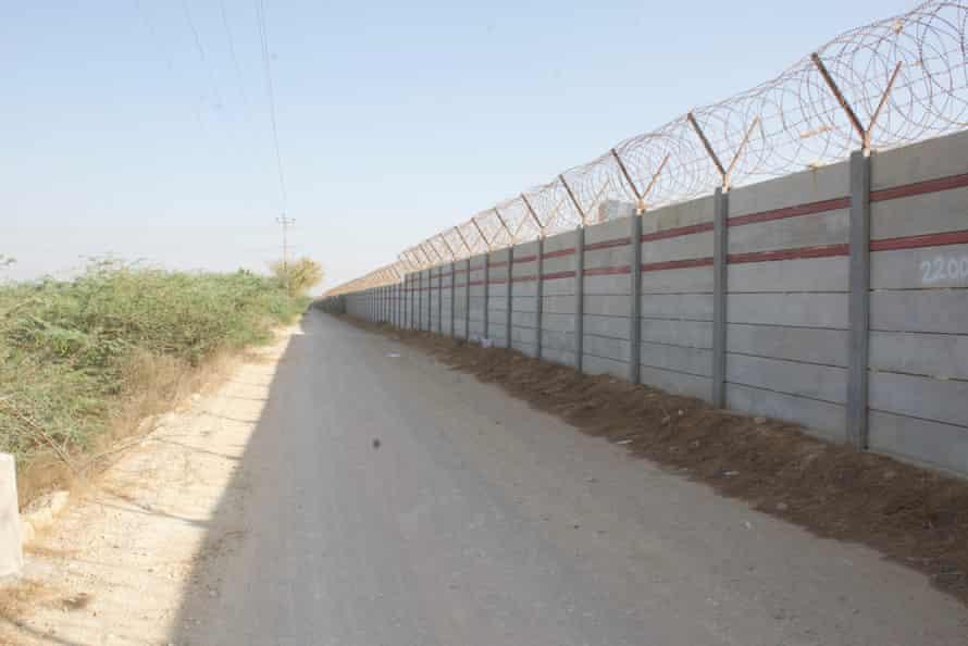 A wall built by Bahria Town Karachi near Gabol village.