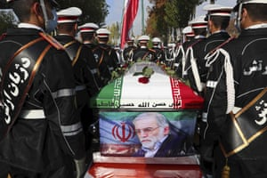 Tehran, Iran: Military personnel stand near the flag-draped coffin of Mohsen Fakhrizadeh, a scientist who was killed on Friday, during a funeral ceremony