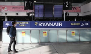 A Ryanair departures board and sign at Dublin airport.