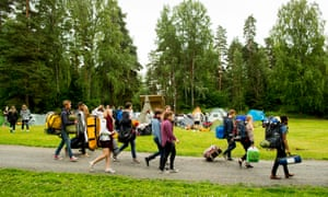 Youths arrive at Utøya Island, Norway, for the first summer camp on the island since 2011.