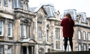Miss M stands outside Edinburgh sheriff court, which ruled that she was raped by Stephen Coxen in 2013.