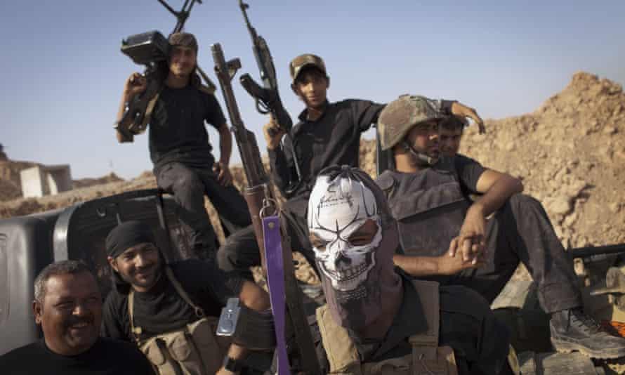 Shia militia members patrol south of Kirkuk