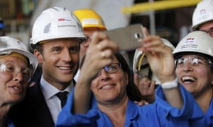 French President Emmanuel Macron poses for a selfie at the STX shipyard site in Saint-Nazaire, western France.